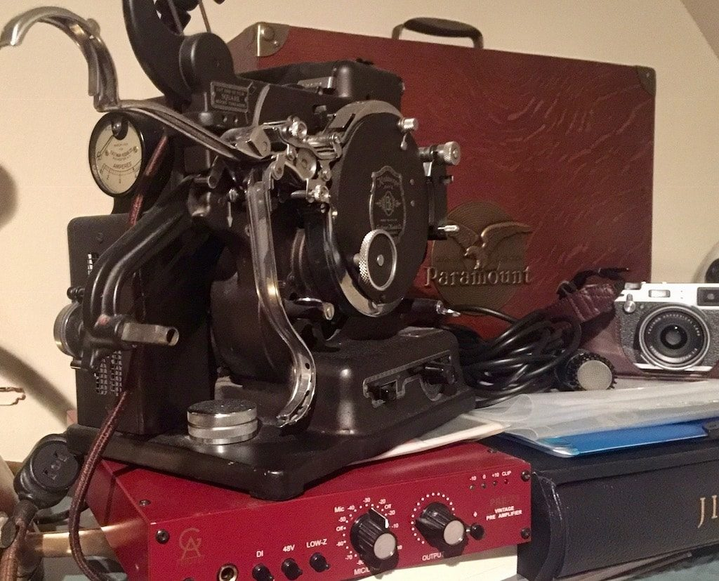 Vintage kodak projector on classic mike preamp, camera, and other miscellaneous items